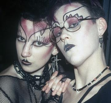 A portrait of two goth women posing in Camden Palace.